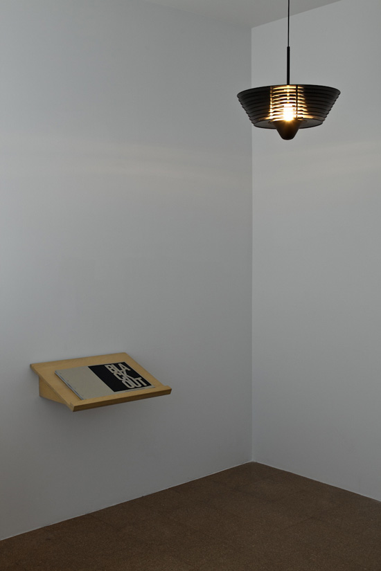 SUPERFLEX & Simon Starling, Black Out (lamps installation view with Black Out book), 2009 Aluminium, paint, electrical cord 20 x 20 x 9 inches