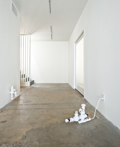 Philippe Parreno, AC/DC Snakes (Installation view), 2010, Electric outlet adapters