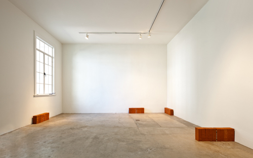 Jorge Mendez Blake, The Art of Loving (Installation view), 2009, 10 bricks and book, 24 x 8 x 4 in., Edition of 10