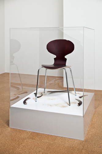 SUPERFLEX, Copy Right, 2007, Wood chair, sawdust, cut-outs, wood platform, plexi-glass box, 35 x 35 x 47 in., Edition 1 of 5