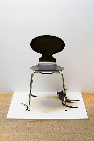 SUPERFLEX, Copy Right (Single Chair), 2006, Brown chair, sawdust, wood cut-outs & platform