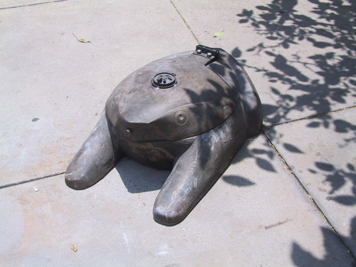 Pae White, Briquettes and Support: Frog, 2003, Cast iron, 40 x 6 x 6 in.