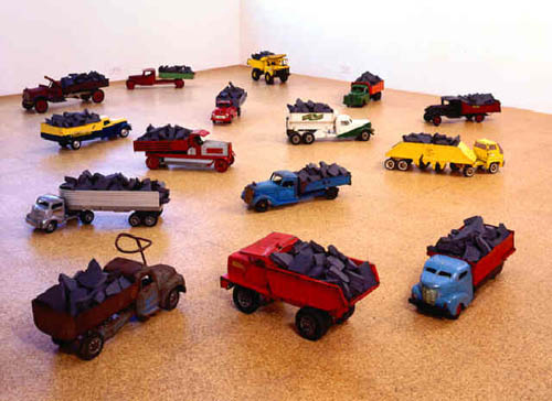 Kate Ericson and Mel Ziegler, Loads of History, 1994-1996, Toy trucks collected from flea markets, black Alabama marble sandblasted with text from used history books