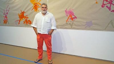 Jorge Pardo poses in front of a new art piece, which he invites children to add to, at the Lux Art Institute in Encinitas.