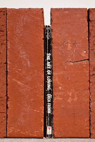 Jorge Mendez Blake, The Art of Loving, 2009, 10 bricks and book, 24 x 8 x 4 in. Edition of 10