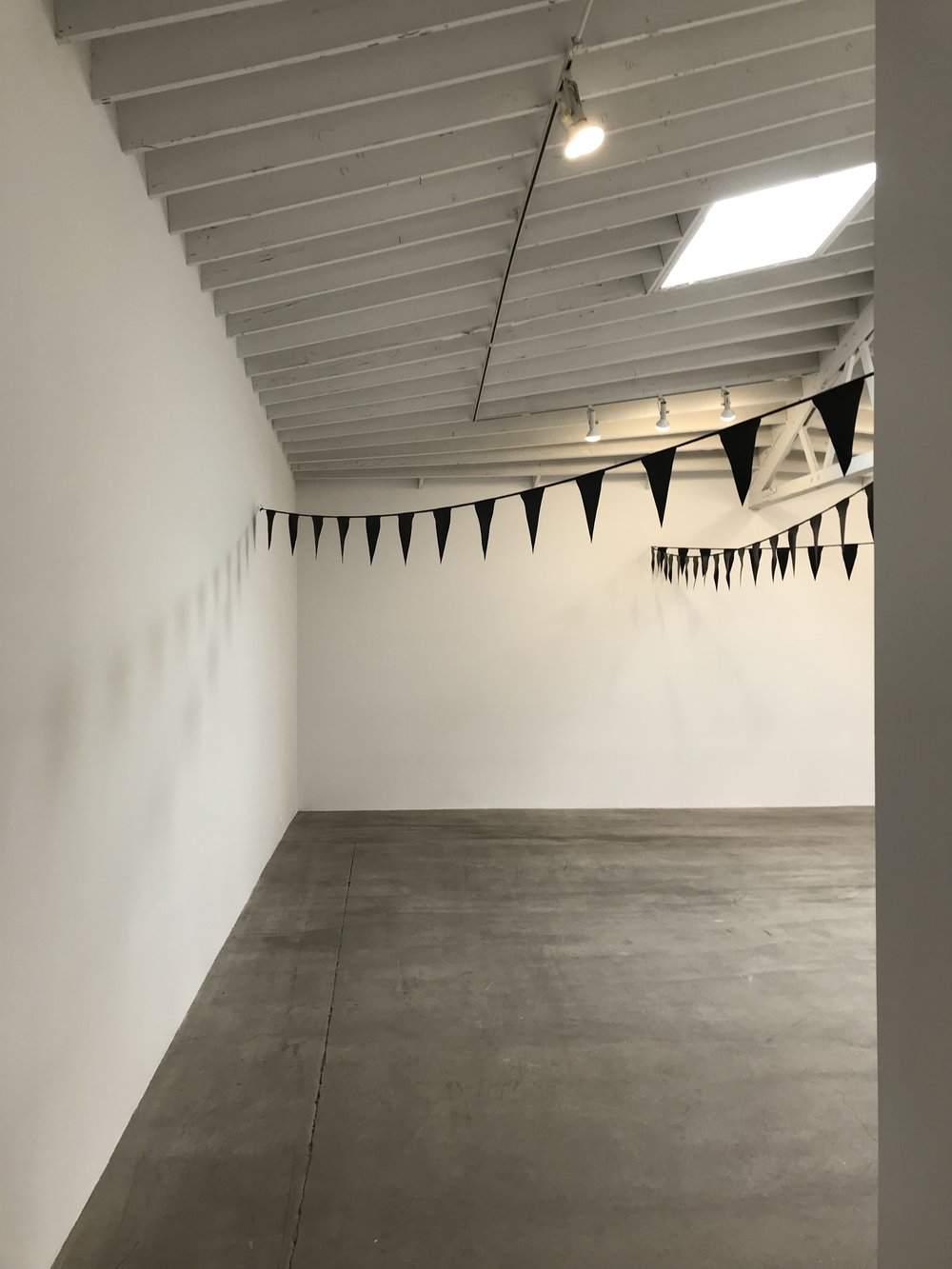 Fiona Banner,  Black Bunting , 2001. Installation view UNIT 5.