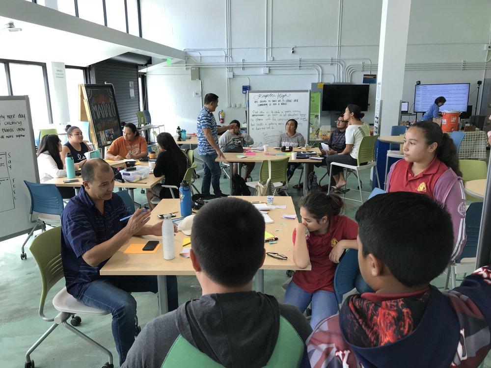 Keoni Lee providing feedback to students from Ka Waihona o Ka Naʻauao PCS on their project ideas.