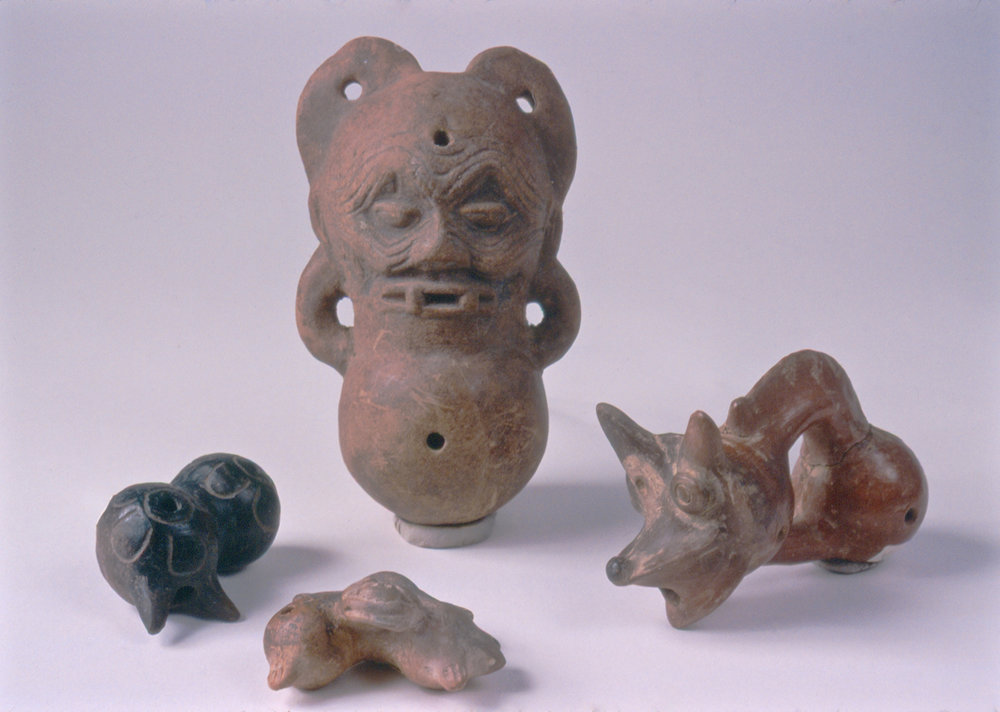 Image: Four polyglobular flutes from private collections.    Polyglobular/ball & tube flutes , from several PreHispanic cultures. The dog form on the right uses two balls & one hollow tube, with a solid support below. Sometimes, the hollow 'tube' is formed by the join or constriction between two or three balls, as in the three additional flutes. The polyglobular form creates an irregular inner volume with an irregular harmonic structure. Thus, each flute has its own distinct melody for a scale.