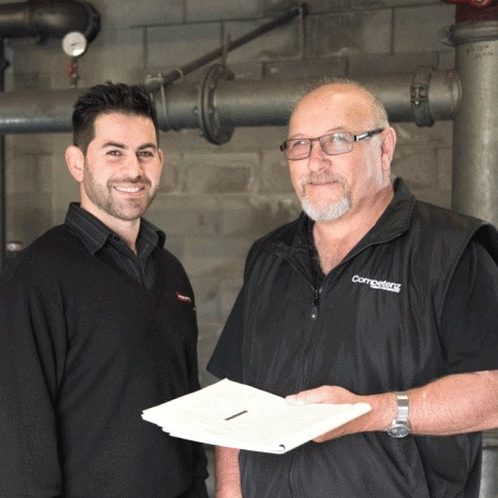 Maz Gharib (left) FSS Northern Region Operations Manager with John Stevenson (right), previously COMPETENZ trainer. Photo taken 2015. Source www.competenz.org.nz