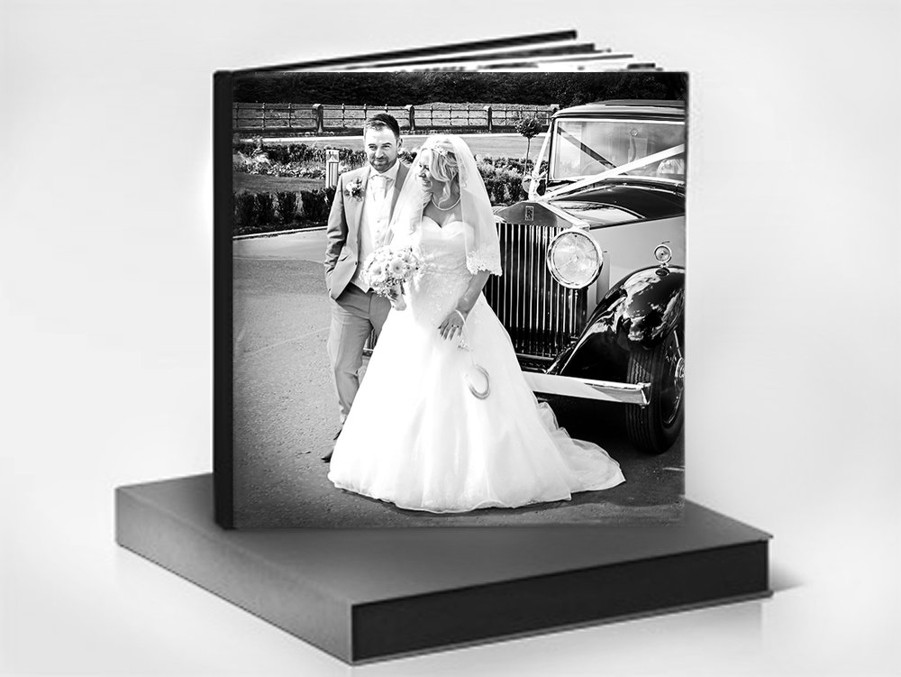 """Album Details  Impressive 90-120 pages  Luxury silk-feel padded hardcover  High quality 260gsm matt photo paper  Stylish clamshell presentation box  Personalised cover and spine  29.5cm x 29.5cm  (11.6""""x11.6"""")"""