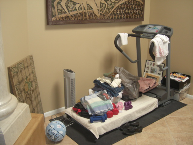 This was what my treadmill looked like before I let it go. Another receptacle of clutter.