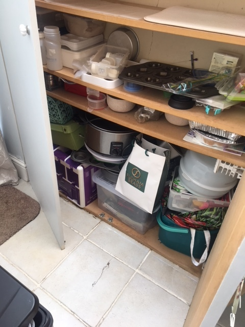 decluttering cupboard before  2.JPG