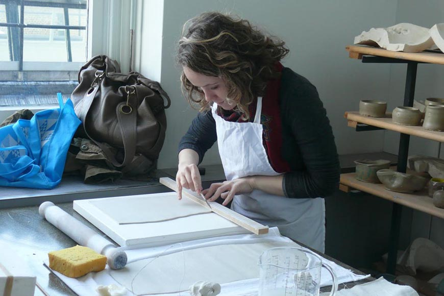 Naomi slab building with porcelain paper clay creating surfaces for mark making research
