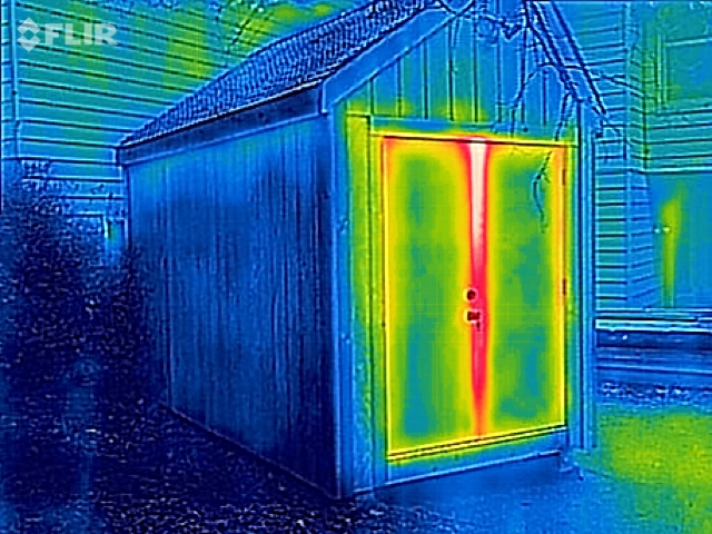 Thermal imaging of a shed constructed with Tstud™walls, floor and roof shows heat loss only through the door. A built-in foam core gives the Tstud™ three times the insulation of a conventional wood stud.