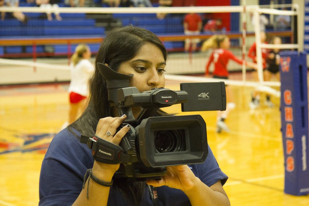 Fiza Sunesera Operating Camcorder b.jpg