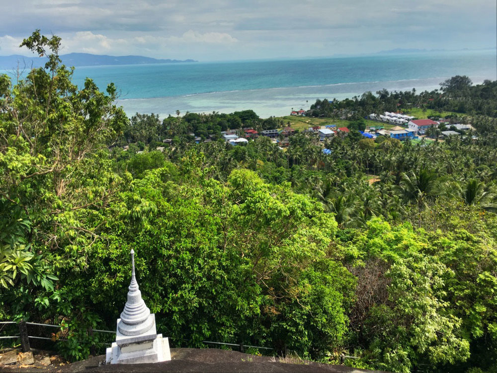 The viewpoint Wat Kohm Tam mountaintop forest monestary overlooking the town of Ban Tai and the island of Koh Samui in the distance.