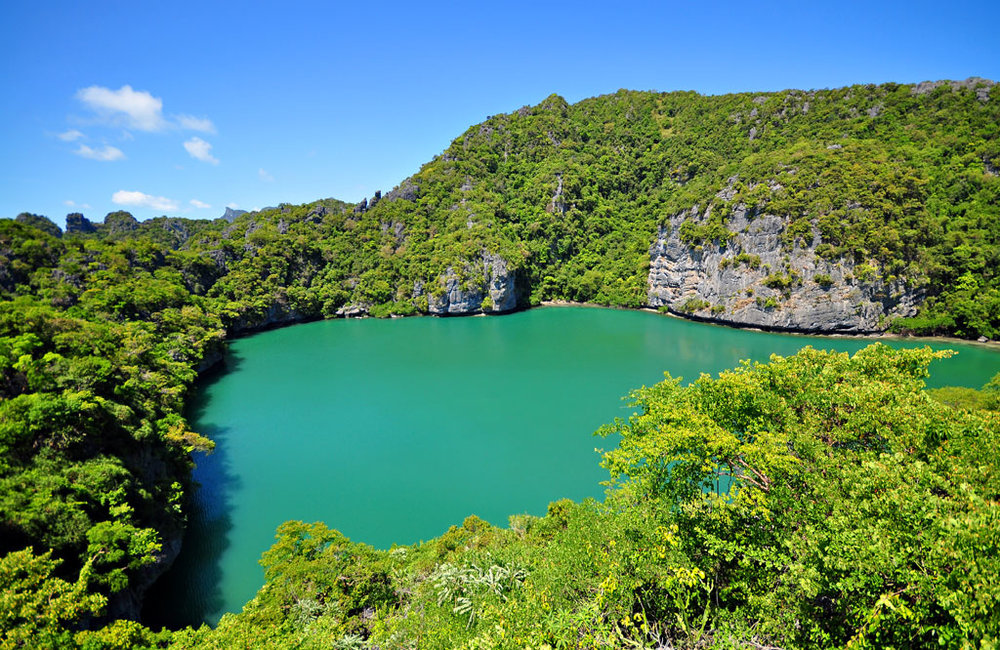 We will hike into the interior of Mae Koh island to see the surreal green colour and thick rainforest of Emerald Lagoon.