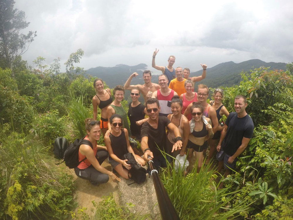 A group selfie at the top of Khao Ra, the highest mountain on the Thai island of Koh Phangan.