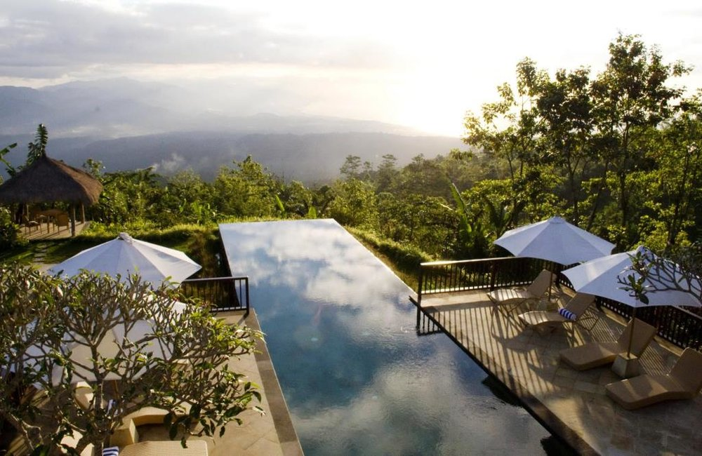 Afterwards we will enjoy dinner and a sunset swim in Bali's most famous infinity pool at the Munduk Moding Plantation Nature Resort, which offers views of the less populated western side of Bali.