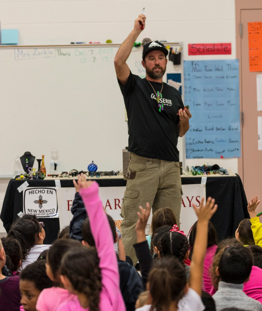 Glasserie's Aari Werber demonstrates his craft for elementary students