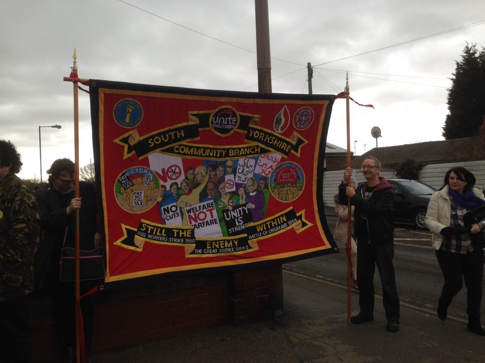 "Stuart Crosthwaite on the right hand side of the picture, holding the South Yorkshire Unite Community banner at the Hatfield Colliery 'anniversary march back"" in March 2015. The pit was closed a few weeks later"