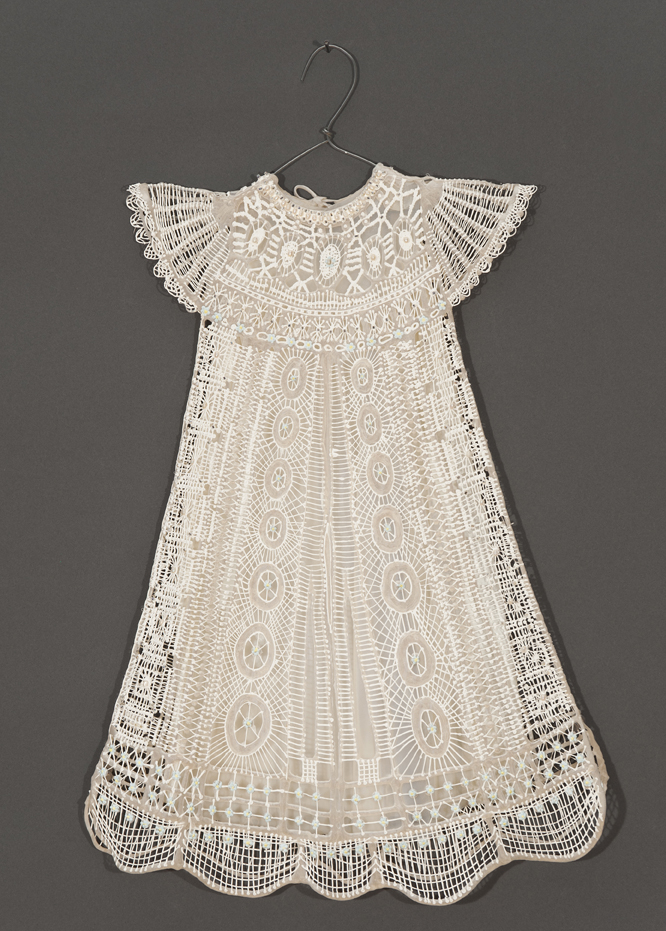White dress with lace on grey background