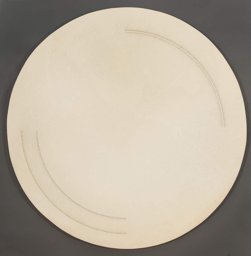 Circular muslin work with gold, silver, and bronze thread