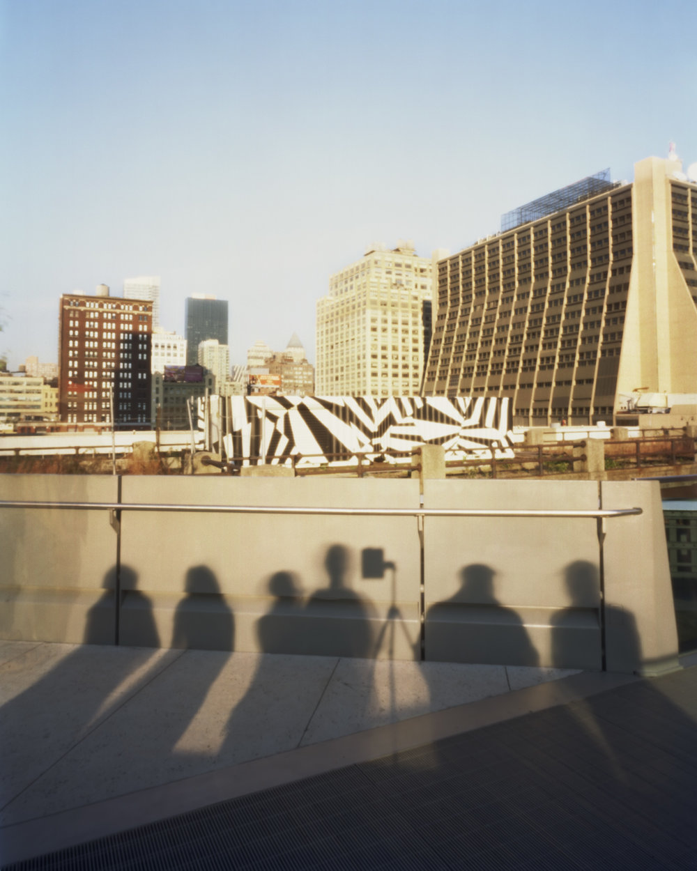 View of buildings from the Highline with shadows of people