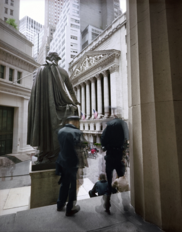Photo of Wall Street with statue and two figures