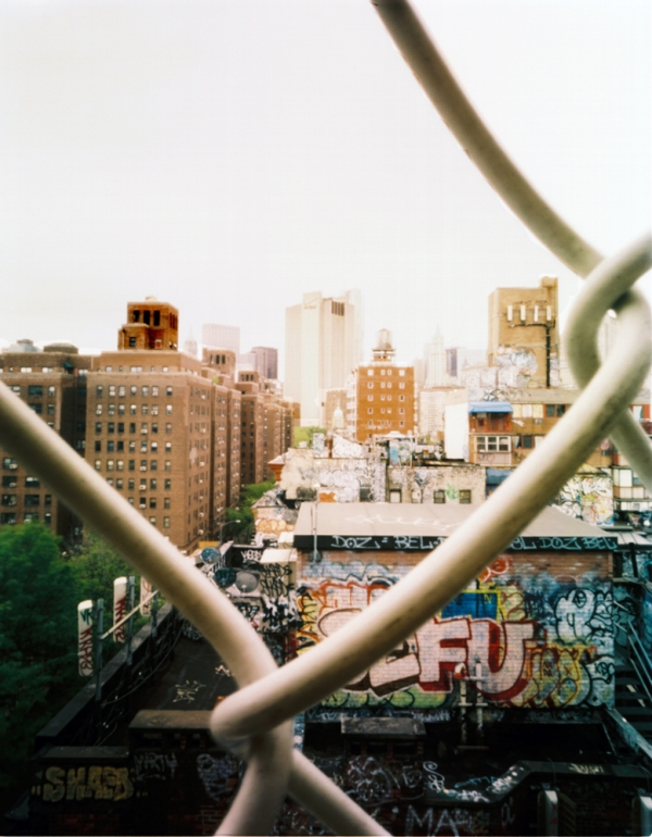 View of Manhattan through chain barrier on bridge