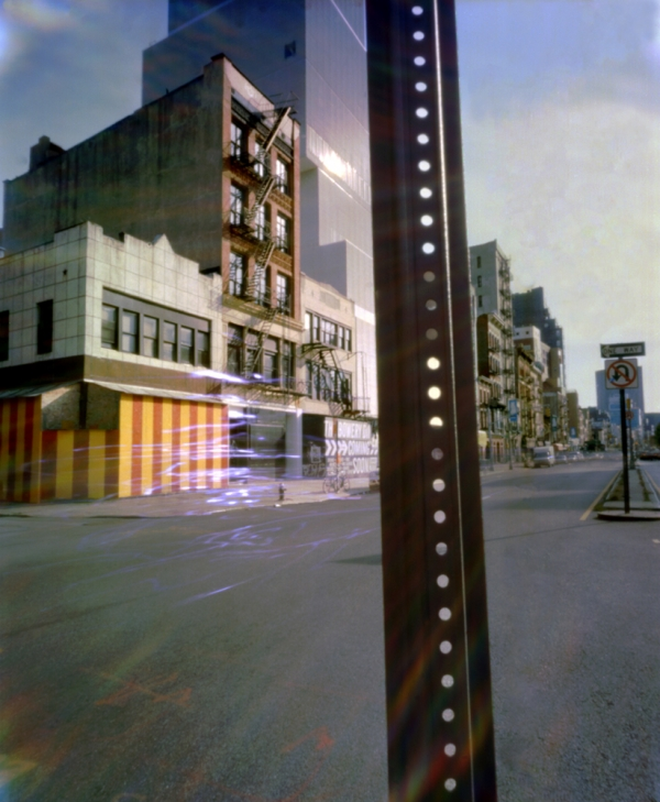 Bowery with pole in foreground