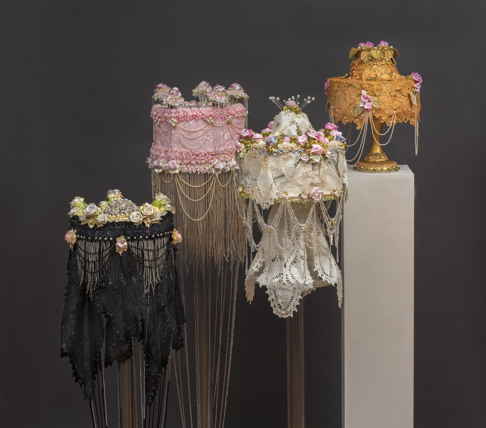 "Pat Lasch # Sept 21 - Nov 3, 2018 <alt= ""Four acrylic cakes with fabric and pearls hanging (black, pink, white, and orange cakes)"">"