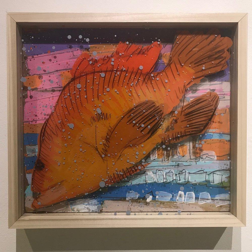 """Orange Trashfish, $550 - 18"""" x 16"""", acrylic and mixed media on Plexiglass and woodContact Tim Jaeger"""