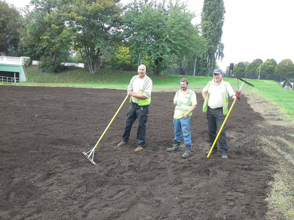 Landscaping with compost mulch for seed sowing.jpg