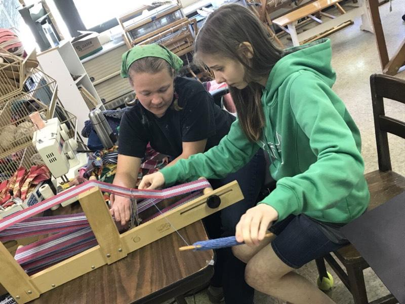 Morgan working the loom with kristin.
