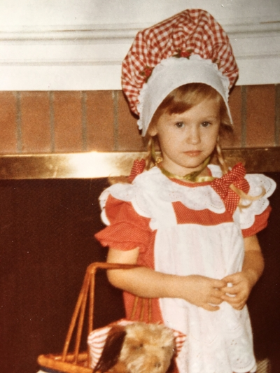 The author as Dorothy (pictured with a blurry Toto) for Halloween, early 1980s.