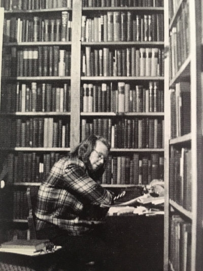 Jackson, seemingly penned in by books, writing in her husband's study, circa 1947.