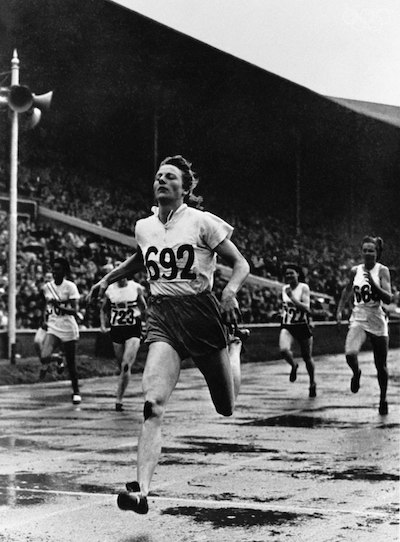 Blankers-Koen crossing the finish line in the 200-meter event, 1948 (photo via Getty images).