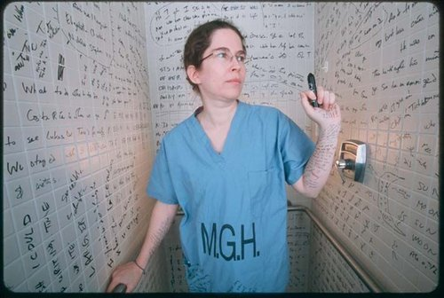 Dr. Flaherty reenacting her hypergraphia (compulsion to write). Photograph by Cary Wolinsky.