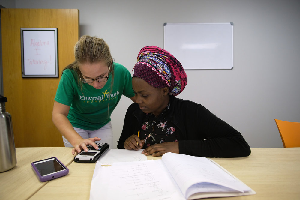 Laura Bean-Allen, left, tutors student Louise Niyogushima at Emerald Youth's Calling & Career Ministry Center.