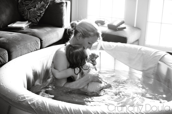 Mom and daughter in birth tub