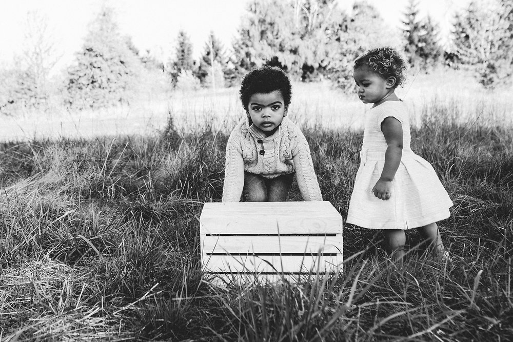 Two children move box at Luscher Farm