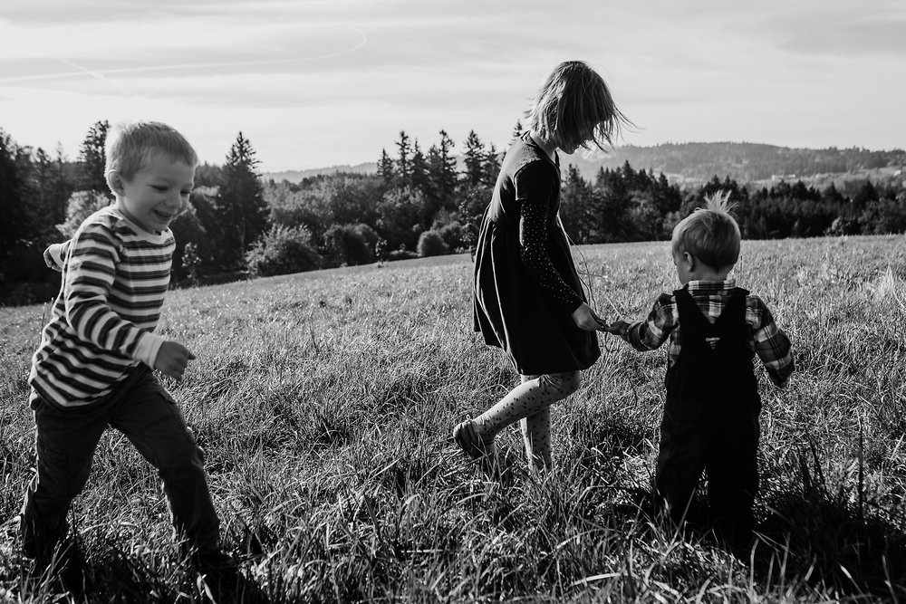 Three kids playing in field