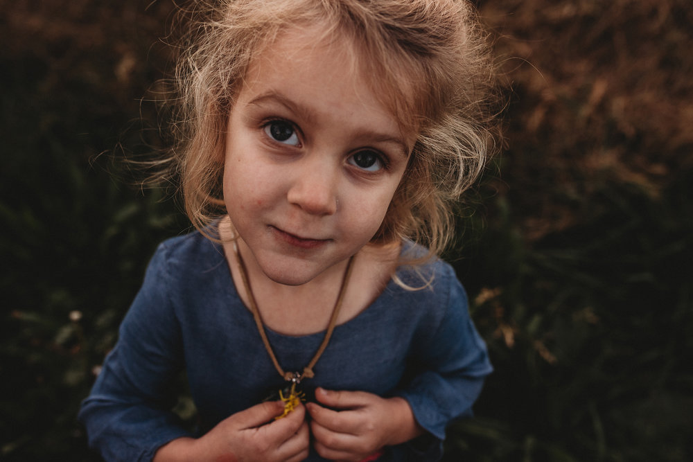 Girl holds necklace