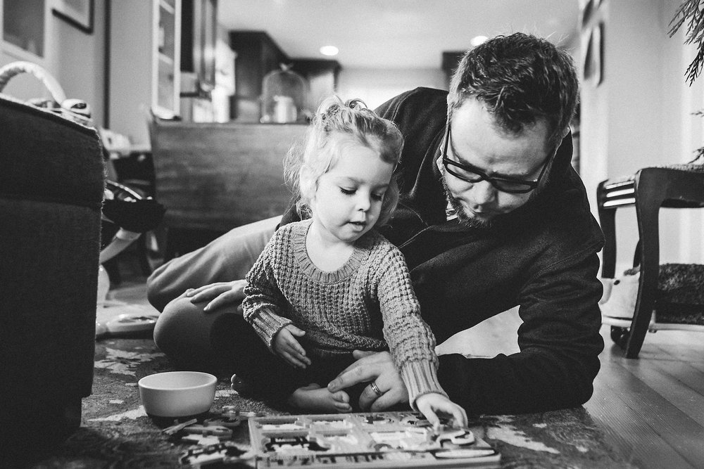 Father and daughter working on a puzzle