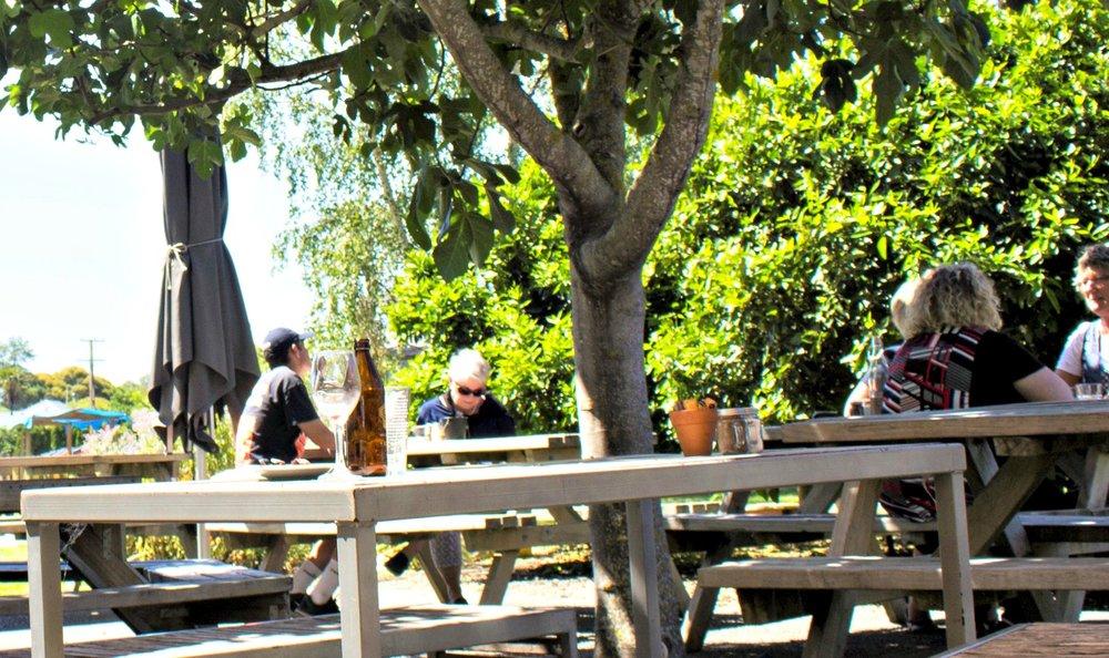 origin-earth-cafe-outside-people.jpg
