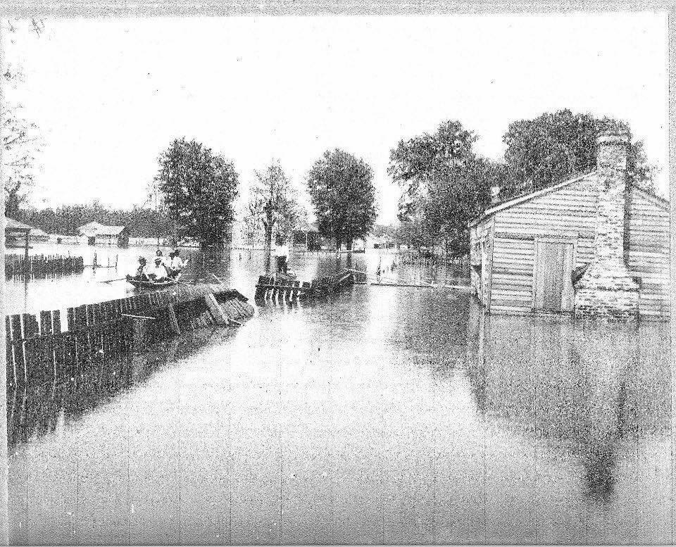 Residents paddling through town during the Flood of 1927