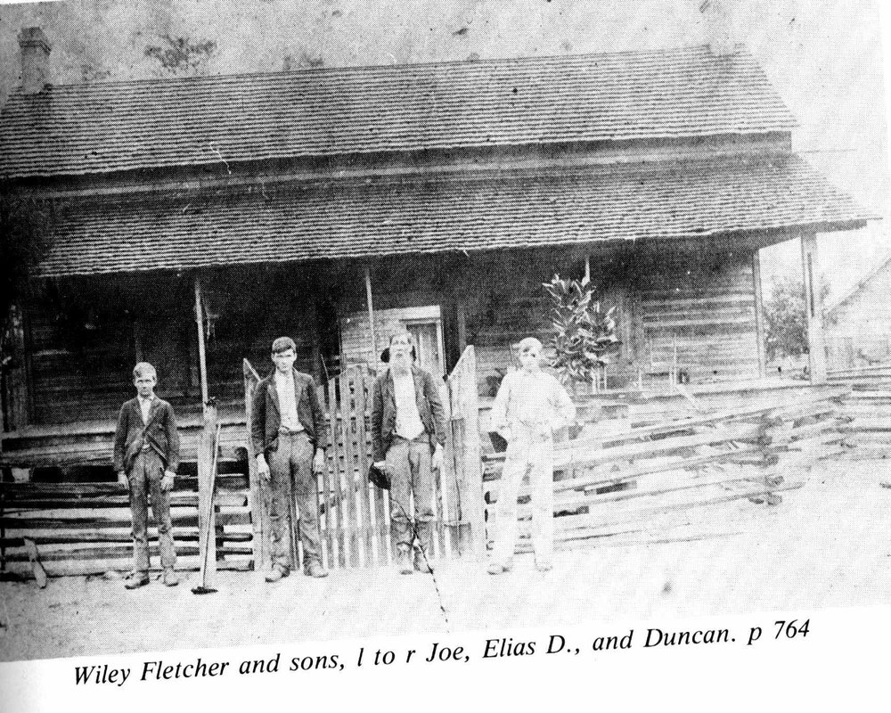 Wiley Fletcher with his sons in front of this home before the dogtrot had been enclosed.