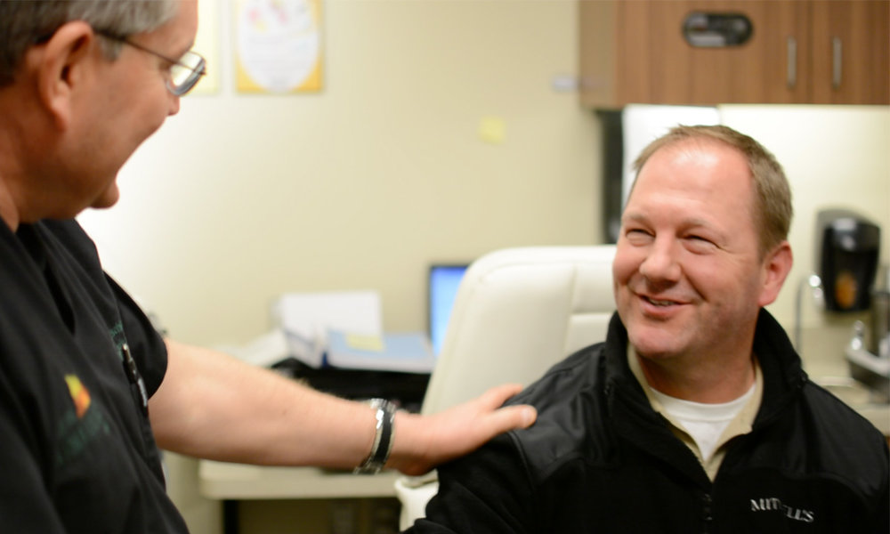 dr-werschler-from-spokane-dermatology-speaks-with-patient.jpg