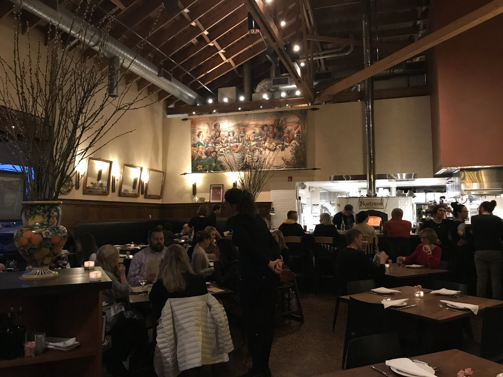 5 p.m. at Nostrana the place is quickly filing up. Reasons? Food to die for and tremendous service. Image Courtesy: Dan Meyers